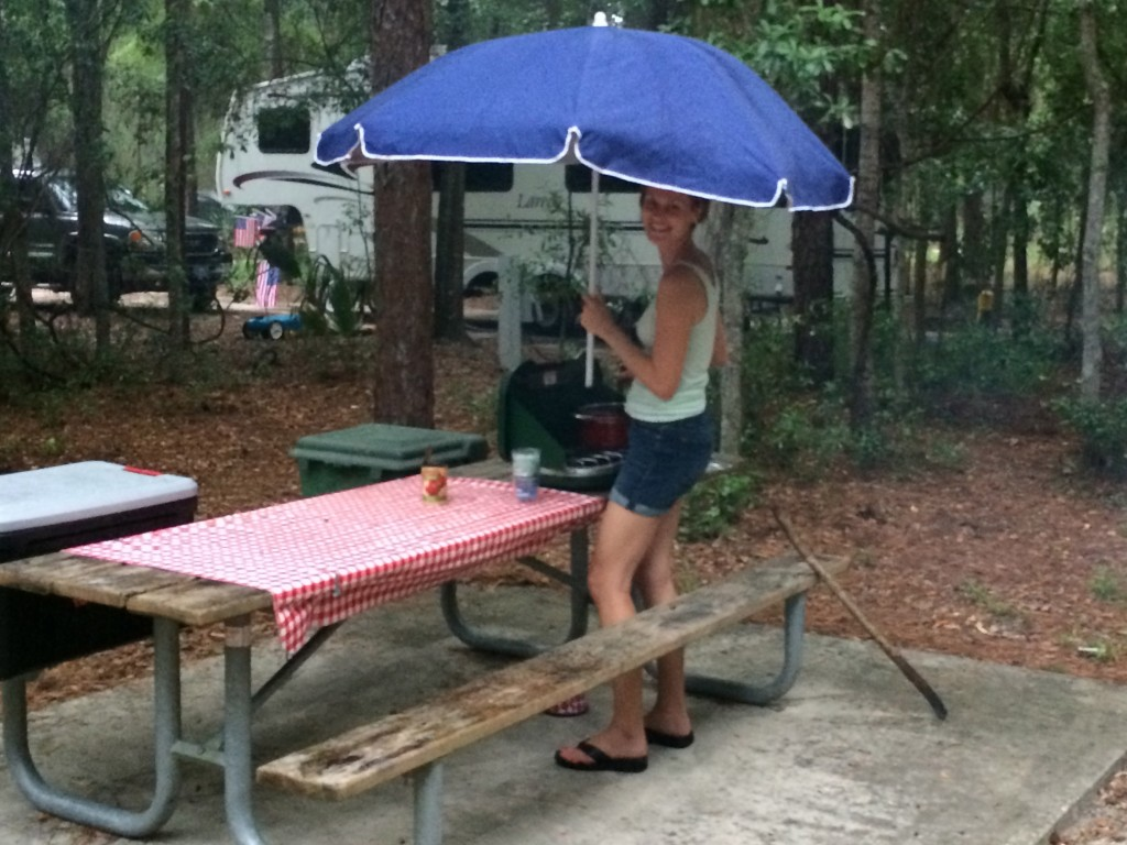 Making dinner in the rain under a beach umbrella